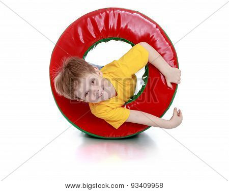 Cheerful little boy playing with a soft round module
