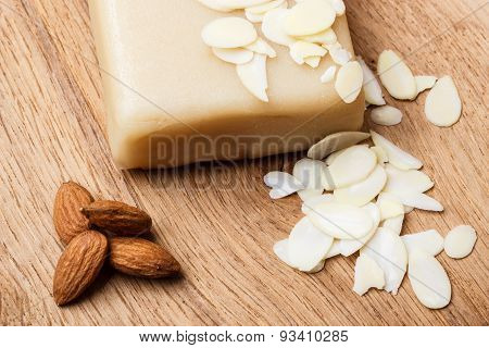 Marzipan And Almonds On Wooden Surface