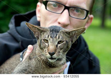 closeup portrait man with his cat