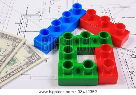 House Of Colorful Building Blocks And Banknotes On Drawing Of Home