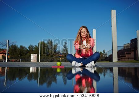 Young beautiful hipster girl take pictures of her self with cell phone