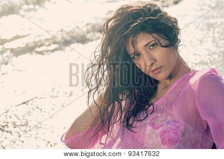 Direct Gaze Of Woman  On The Seashore Warm Filter