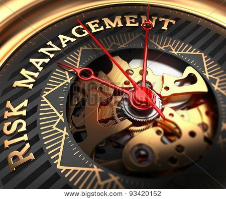 Risk Management on Black-Golden Watch Face.