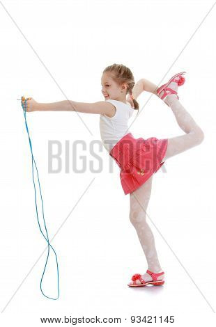 Beautiful girl with a yellow skipping rope in your hands