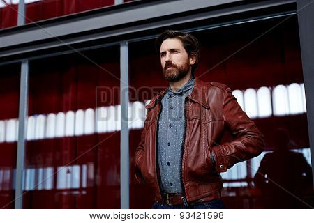 Portrait of fashionable mature hipster man dressed in pattern shirt standing indoors