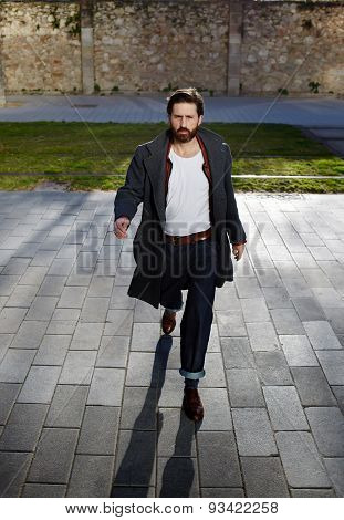 Portrait of attractive strong man is dressed stylish walking the streets on a sunny day