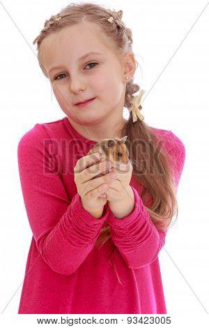 Girl school girl holding a hamster