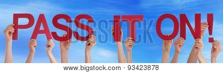 Hands Holding Straight Word Pass It On Blue Sky