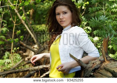 Girl In A Summer Forest On A Sunny Day