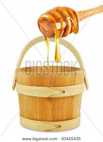 wooden bucket with honey