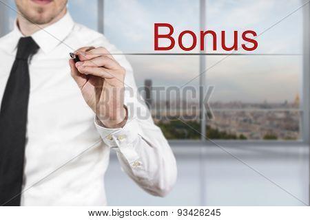 Businessman Writing Bonus In The Air