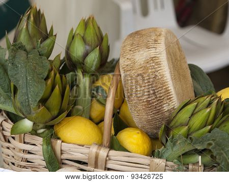 Wicker Basket With Cheese And Vegetables