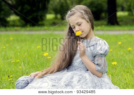 Kid Enjoys Flowers In The Park