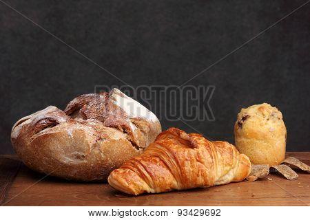 Sour Dough Bread Croissant Muffin On Teak