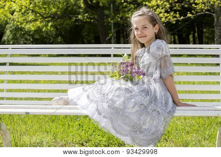Girl Lovely Rests In A Sunny Park