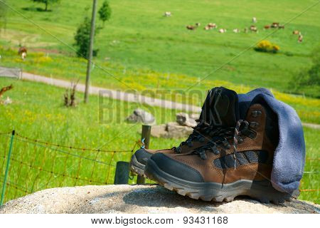 Hiking Boots With Socks On A Rock