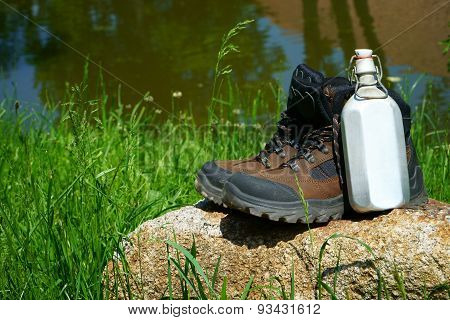 Hiking Boots And A Canteen