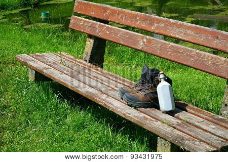 Hiking Boots On A Seat Bench