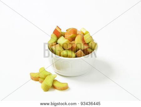 bowl of chopped rhubarb on white background