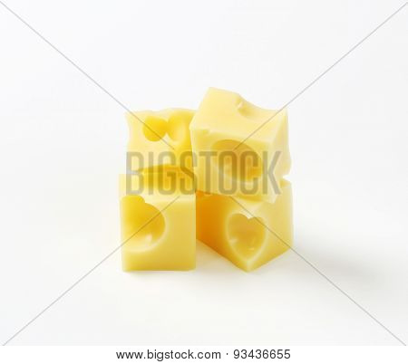 cubes of fresh emmental cheese on white background