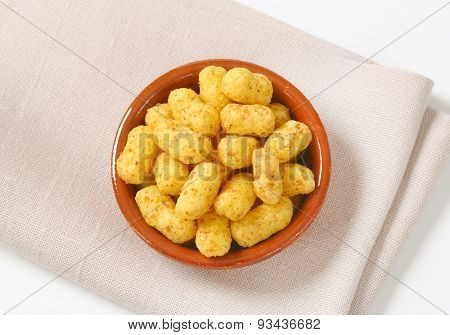 bowl of peanut crisps on folded place mat