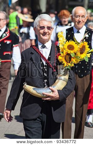 ZURICH - AUGUST 1: Swiss National Day parade on August 1, 2009 in Zurich, Switzerland. Representative of canton Sankt Gallen in a historical costume.