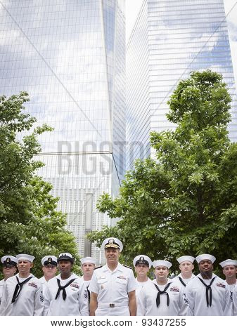 NEW YORK - MAY 22 2015: Admiral Phil Davidson stands by the Freedom Tower with personnel taking part in the re-enlistment ceremony at the National September 11 Memorial site during Fleet Week 2015.