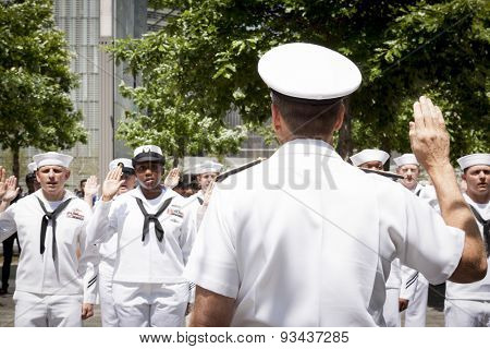 NEW YORK - MAY 22 2015: Admiral Phil Davidson, Commander, US Fleet Forces Command, swears in personnel during the re-enlistment and promotion ceremony at the National September 11 Memorial site.