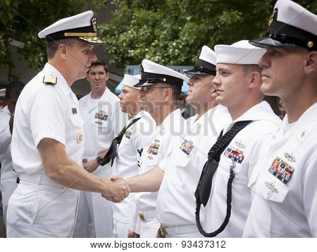 NEW YORK - MAY 22 2015: Admiral Phil Davidson shakes the hand of a U.S. Navy sailor who took part in the re-enlistment and promotion ceremony at the National September 11 Memorial site.