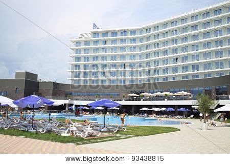 SOCHI, RUSSIA - JUL 25, 2014: Area of the Hotel Radisson Blu Paradise Resort and Spa with people resting by the pool