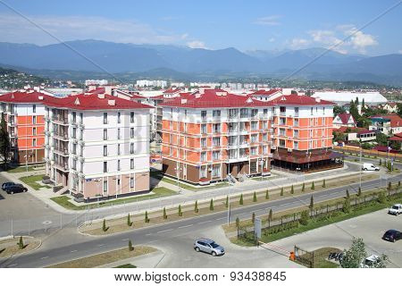 SOCHI, RUSSIA - JUL 25, 2014: The view from the Hotel Radisson Blu Paradise Resort and Spa to the street 65 years of Victory with new housing estate and mountains