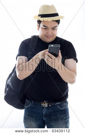 Asian Man Texting Message At His Mobile Phone