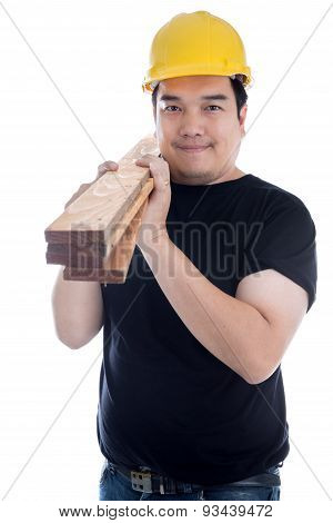 Portrait Of Asian Smiling Carpenter Holding Wood Planks.