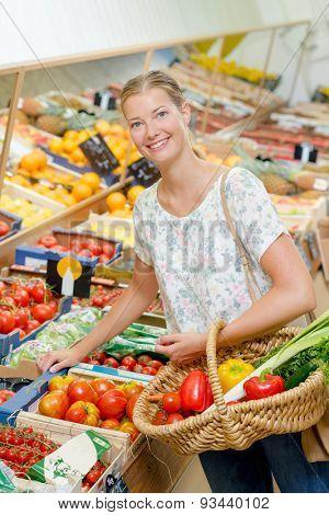 Lady choosing fruit and veg