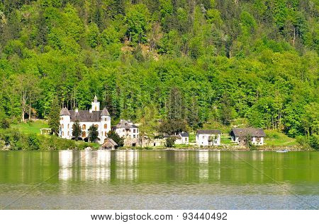 Palace on the lake Hallstatter in Austrian Alps.