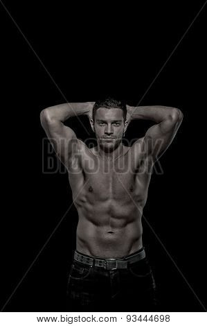 Glamour Young Handsome Athletic Man On Black Background