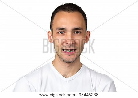 Photo of smiling man with brackets