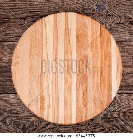 Round Cutting Board On An Old Table