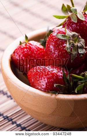 Fresh Red Strawberry in wooden bowl