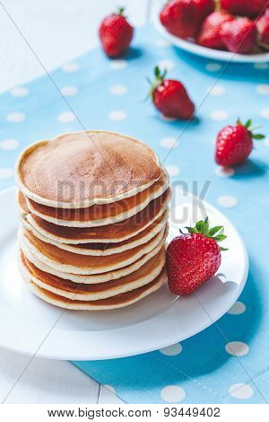 Pancakes traditional homemade sweet dessert with strawberry on provence style background