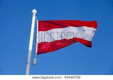 Waving flag of Austria against the blue sky