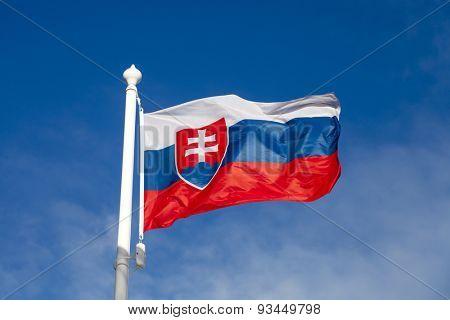 Waving flag of Slovakia against the blue sky