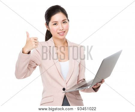 Businesswoman holding laptop computer and thumb up