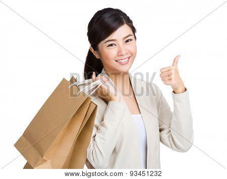 Asian woman holding shopping bag and thumb up