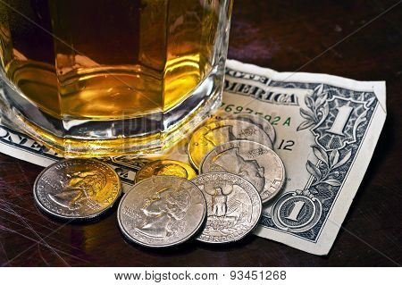 Tip Money Left On Counter Under Drink
