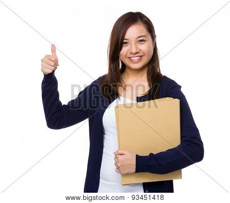 Young girl holding document work and thumb up gesture