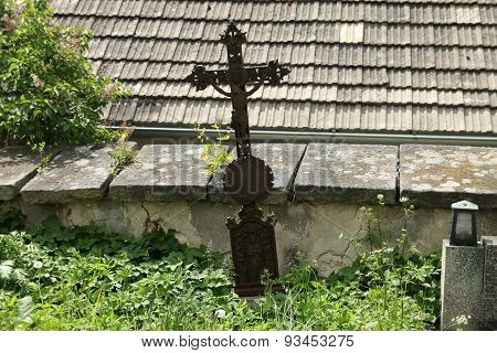 Cross At The Cemetery Wall
