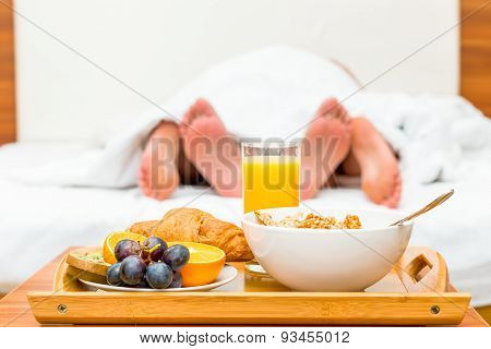 Couple In Bed, A Tray Of Food In Focus
