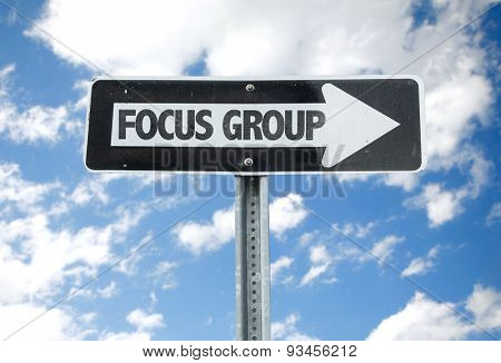 Focus Group direction sign with sky background