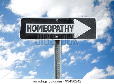 Homeopathy direction sign with sky background